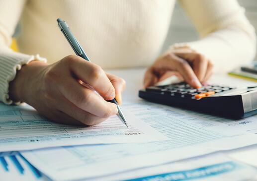 closeup-woman-filling-form-of-individual-income-tax-return-picture-id1226748605